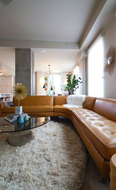 shag carpet, mid-century modern sectional, glass coffee table