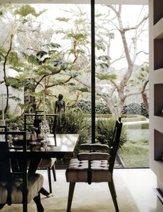 dining room with wood and crystal, tropical, large glass windows
