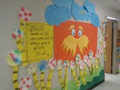 The Lorax with Truffula Trees made from paper, paper towels & plates, food coloring, and water!