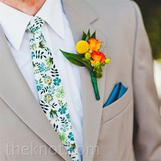 Spray roses, billy balls and greenery popped against the guys' tan suits.