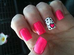 Hot pink nails with white & hearts.