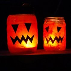 Easy Halloween Lantern craft with recycled baby food jars/jam jars, watered down glue, and orange tissue paper.