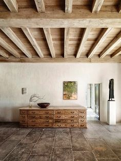 axel vervoordt, exposed beams, floors, interiors, tile flooring, wall textures, ceiling beams, ceiling detail, wood ceilings