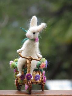 Needle felted white bunny riding bike, spring home decoration. $82.00, via Etsy.