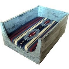 Rustic dog bed - this would be an easy DIY using an old dresser or desk drawer, fabric, and a pillow insert.