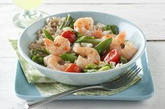 Shrimp and Rice Stir-Fry-This is an easy recipe for a meal that your guests and family will not believe you made. They will think you hired a chef. It's delicious and so easy to put together; also a WeightWatchers (7) Points+ recipe. Made with shrimp, bok choy, tomatoes, sugar snap peas and brown rice. Makes 4 generous 1-2/3 cup servings.