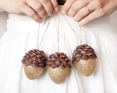 I made these shimmering acorns with real pine cone pieces, hollow mache ball cores, and two colors of beautiful crystalline glitter.   Each acorn glitter ornament measures 2 1/2 inches in length, and has a 4 inch twine loop for hanging.