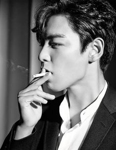 Choi Seung-Hyun smoking a cigarette (or weed)