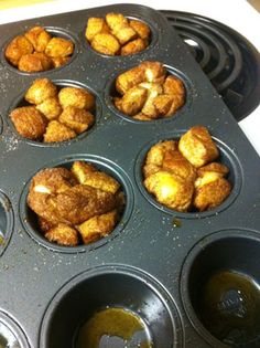 """Mini Monkey Bread Made Easy  Materials:    One can/package of Pillsbury Dinner Rolls, or brand of prepared dinner rolls.  Half a stick of butter  Cinnamon and sugar to taste  Non-stick spray  A cupcake pan, or my personal favorite, a """"perfect brownie"""" pan"""