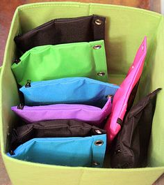 Use zippered pencil pouches to organize puzzles instead of storing the bulky boxes. Cut off the image from the front of the box and store it in the bag, too. I've been using ziplock bags all this time! This blog post has several great ideas for organizing kids toys.