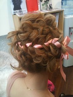 curly messy braids with ribbons :)