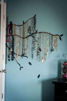 kinda makes me want to actually start wearing lots of necklaces just so i can hang them on the wall and make it look like a willow tree!! dorm room, jewelry hanger, jewelry displays, diy jewelry, necklace holder, tree branches, jewelry holder, jewelry tree, painted walls