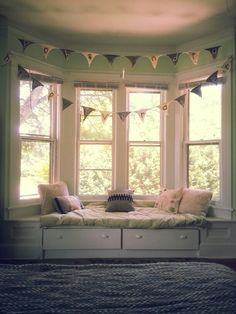 I've always wanted a window seat. Liking the bay window, too.