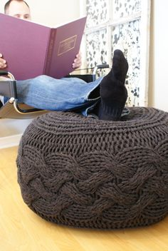 This oversized cabled knitted pouffe footstool/ottoman is pretty awesome. I'd love to make a bunch of these in bright playful colors.