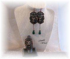 """My entry for October challenge """"Bodacious ring and earrings, using the rusty black owls from b'sueboutiques.com. I made the ring shank myself from copper sheet. It is 1/2"""" wide and adjustable. The owls all have teal green eyes, and are sitting atop antique copper filigree. The earrings are a little over 3"""" long and have copper chain drops with teal green faceted glass beads with bead caps. $48.00 for set"""