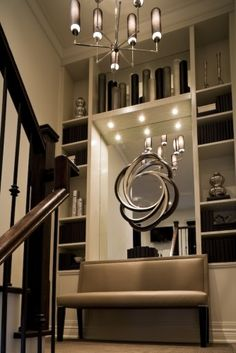 mirror, interior design, wall decor, bookcases, staircas land, stairway, pendant lights, homes, basements