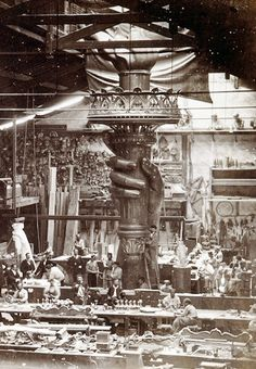 1876, France: The Statue of Liberty's right hand and torch being built in a Paris studio. #americanhistory #history #StatueofLiberty