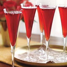 CHAMPAGNE-POMEGRANITE COCTAIL  1 cup pomegranate juice   1 750-ml. bottle champagne or sparkling wine $           Pomegranate seeds, optional     Preparation  Divide pomegranate juice among 8 champagne flutes. Top off each glass with champagne. Garnish with a few pomegranate seeds, if desired.