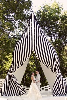black and white striped wedding tent as the backdrop for the ceremony! If I weren't getting married in a church I would have done something like this.