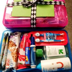 Teacher Survival Kit as a Back 2 School gift. Kit includes: pencil box, cereal bars, flavored water packets, breath mints, emergency toothbrush, mini lint roller, tide pen, hand sanitizer, hand lotion, pain reliever, vitamin c drops, & lip balm.