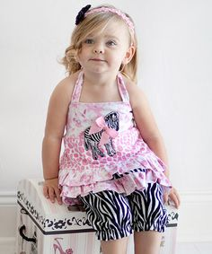 Take a look at this Nesting Baby Pink Zebra Tunic & Capri Pants - Infant & Toddler by It's A Zoo: Apparel & Accessories on #zulily today!