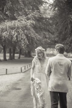 Kelly Reilly and Kyle Baugher walking down a tree lined lane in Somerset by Ria Mishaal Photography