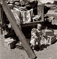 """August 1939. Migratory children living in """"Ramblers Park."""" They have lived on the road for three years. Nine children in the family. Yakima Valley, Washington. Photograph by Dorothea Lange."""