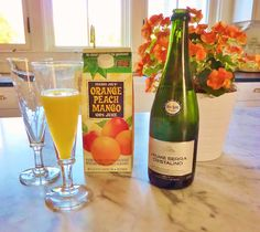 Trader Joe's Orange Peach Mango Juice mixed with Jaume Serra Cristalino, Cava Brut champagne is a delightful blend!