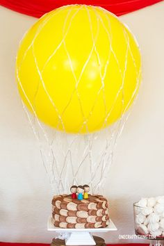 Hot Air Balloon themed first birthday party! The photo booth she set up is fantastic.