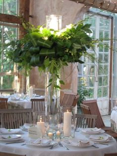 Great look for inside church entrance, but all green foliage design with candle centerpiece emerald green wedding