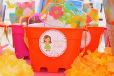 Luau party favor buckets http://www.prettymyparty.com/luau-themed-2nd-birthday/