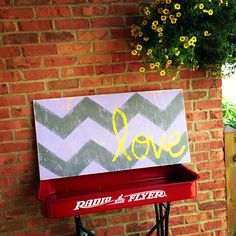 Chevron love distressed wood sign. Purple, gray, and yellow