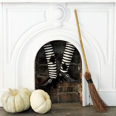 Make it appear that an unlucky witch has gotten stuck in your chimney with this wickedly-fun fireplace decoration: http://www.bhg.com/halloween/decorating/witch-decor-for-halloween/?socsrc=bhgpin100614witchinfireplace&page=2