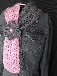 Sadly, this pin goes nowhere, just back around to pinterest.  Here's what I would do for the pattern:  make a regular keyhole scarf (search Ravelry if you don't have a pattern) and add a decorative flower (bullion stitch?) on the pink half.