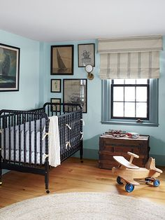 This Jenny Lind crib is from Amazon. The walls are painted Yarmouth Blue by Benjamin Moore.