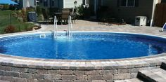 beautiful semi inground pool, I want one!! my dad would like it to.