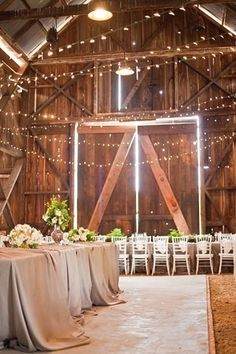 Beautiful, christmas lights and wedding elegance against the rustic barn