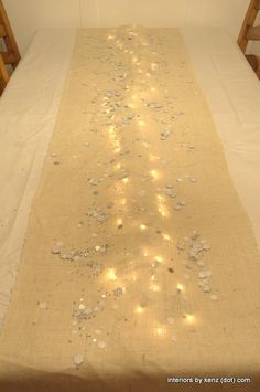 Strand of lights under burlap for a simple holiday table-scape