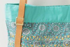 Travel in style wherever you go with this pretty and practical tote bag, whether you're boarding a plane, rushing to a meeting, or just heading to the grocery store. Big enough to hold your purse and other essentials without overflowing, this roomy tote bag adds a cheery pop of color to any wardrobe.