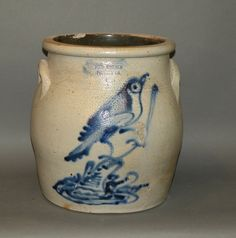 "ca. 1880; salt glazed with brushed cobalt bird sitting on a stump and impressed ""Fort Edward Pottery Co. 2"" with applied lug ear handles and Albany slip interior glaze, 10 ¼""d, 10 5/8""h;"