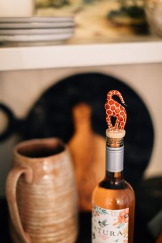 Bottoms up! The Wood Giraffe Bottle Topper is handcrafted by artisans working with OTICART in Kenya. OTICART provides income opportunities to makers living in and around Nairobi who would otherwise be unemployed or underemployed.