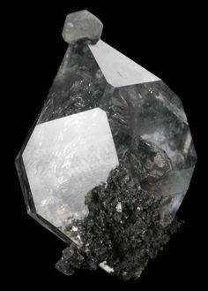 Calcite on Quartz var. Herkimer Diamond.
