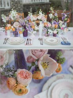 Purple, blue, pink, and orange table decor. Captured By: Christine Sara Photography #weddingchicks --- http://www.weddingchicks.com/2014/06/16/these-vintage-dresses-will-captivate-your-romantic-side/