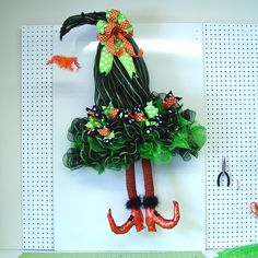 Tutorial for Deco Poly Mesh Witch Hat with Dangling RAZ Witch Legs - Trendy Tree Blog door idea, witch hat