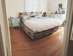 Nautical bedroom with pallet bed frame.
