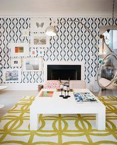 Living Room Modern Photo - A mix of patterns grounded by a square white coffee table