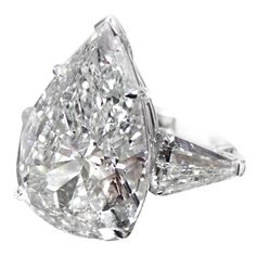 Stunning Pear-Shaped Diamond Ring 10.33 Carats GIA  USA  21ST Century  Magnificent Pear shape diamond ring. The diamond looks like 11 CT.   The Center Diamond is 10.33 CT G Color, SI 2 in Clarity     GIA Certified.    Surrounded by 1.46 Ct total weight of diamonds.  Price  $218,000