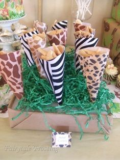 It amazes me how such simple products, like animal print scrap book paper can make a huge contribution to a theme baby shower. It is great for storing and displaying treats or baby shower favors. Jessy from Fairytalefrosting.com came up with this inspired idea.