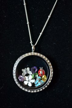 Spring Origami Owl Living Locket.  FREE CHARM WITH A $25 OR MORE PURCHASE... Contact me to place your order YourCharmingLocket@gmail.com or message me on Facebook https://www.facebook.com/YourCharmingLocket. ---LIKE OUR FAN PAGE FOR A CHANCE TO WIN A FREE CHARM. 3 WINNERS EVERY MONTH--- Want more than just one locket, consider joining our team for an extra income.