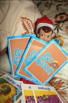 Elf on the Shelf Ideas –  Elf Plays Go Fish and other daily Elf on the Shelf Ideas. New Ideas Daily. Free Note for your Elf Friend.